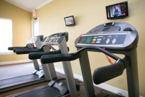 Treadmills located in Haverhill Place's Workout Center.